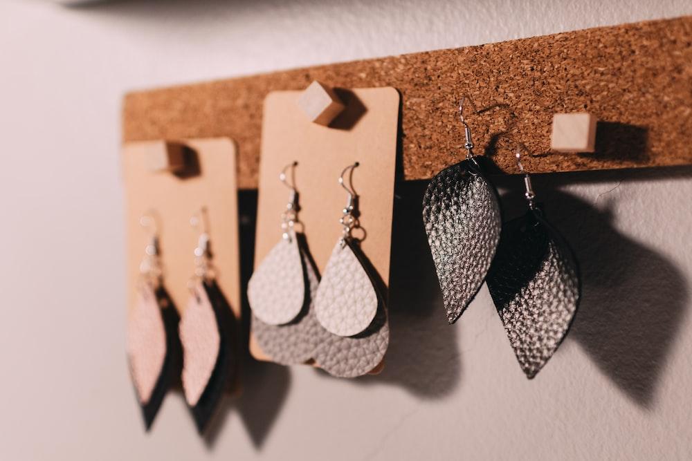 three pairs of silver hook earrings