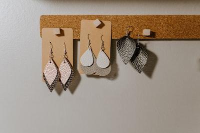 three pairs of hook earrings craftsman zoom background