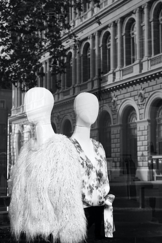 mannequin wearing white coat