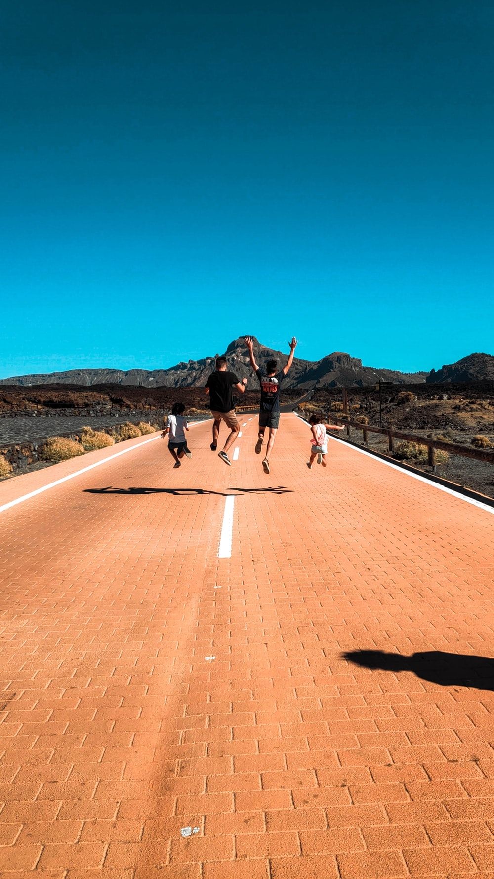 people standing on road