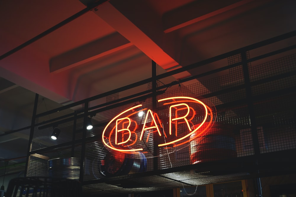 red bar neon signage