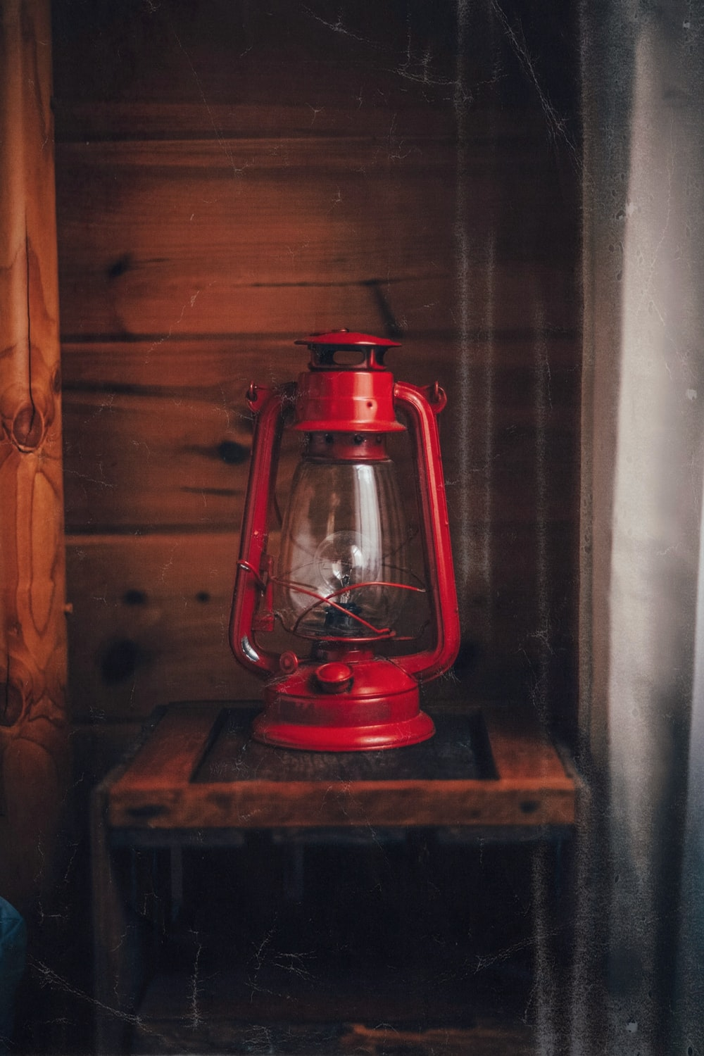 red lantern lamp on brown wooden table