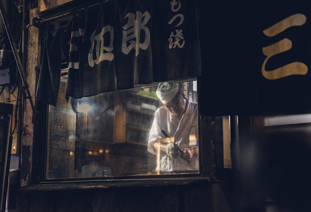 chef standing in front of glass wall