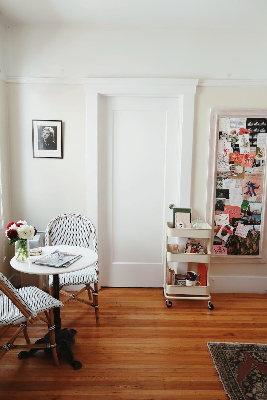 white 3-layered rack beside closed door