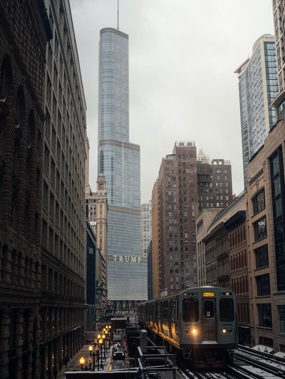 grey train beside buildings