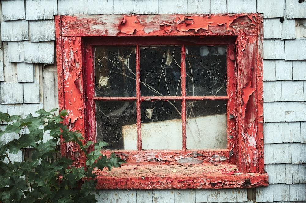 red framed glass window