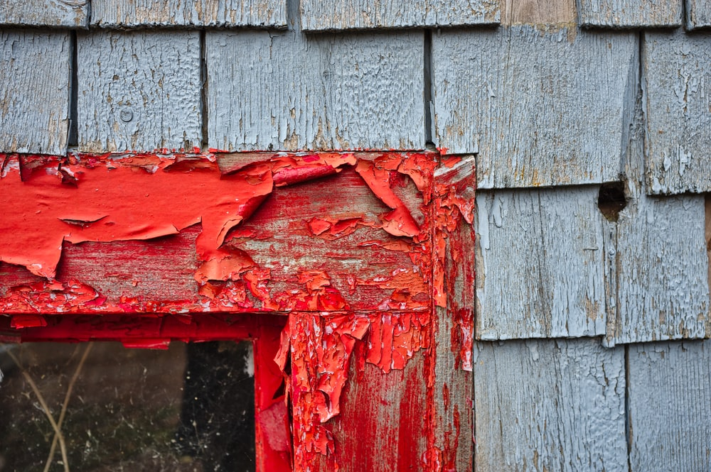 red paints on wooden frame during daytime
