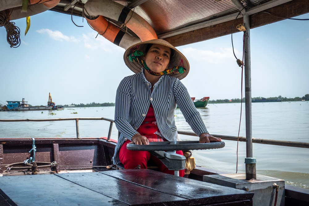 woman riding boat during daytime