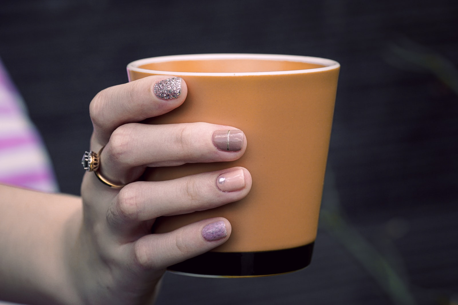 """Sony a6000 sample photo. """"Person holding orange cup"""" photography"""