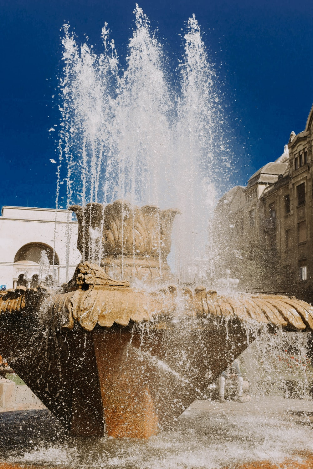 brown outdoor water fountain during daytime