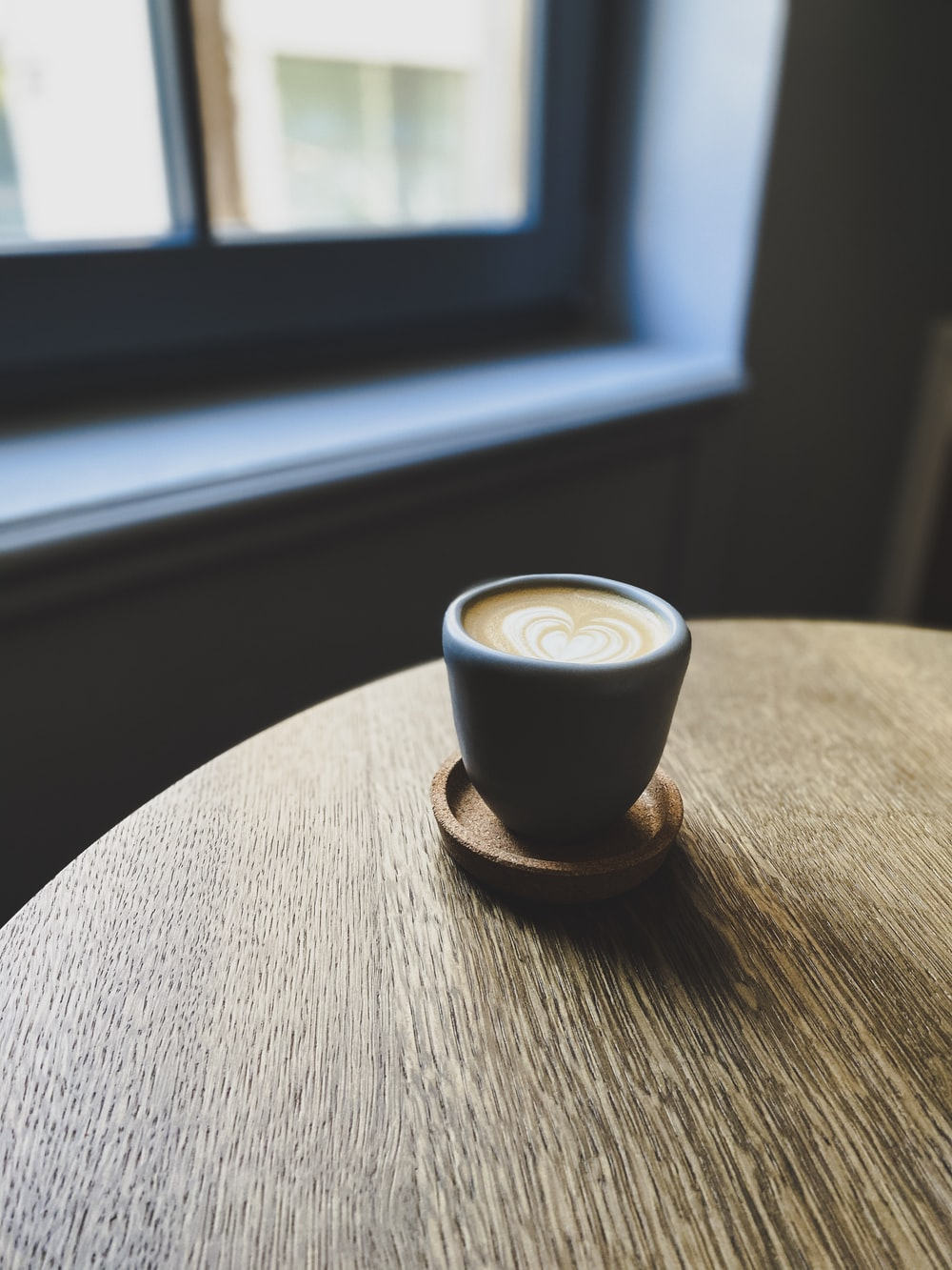 black ceramic cup with coffee