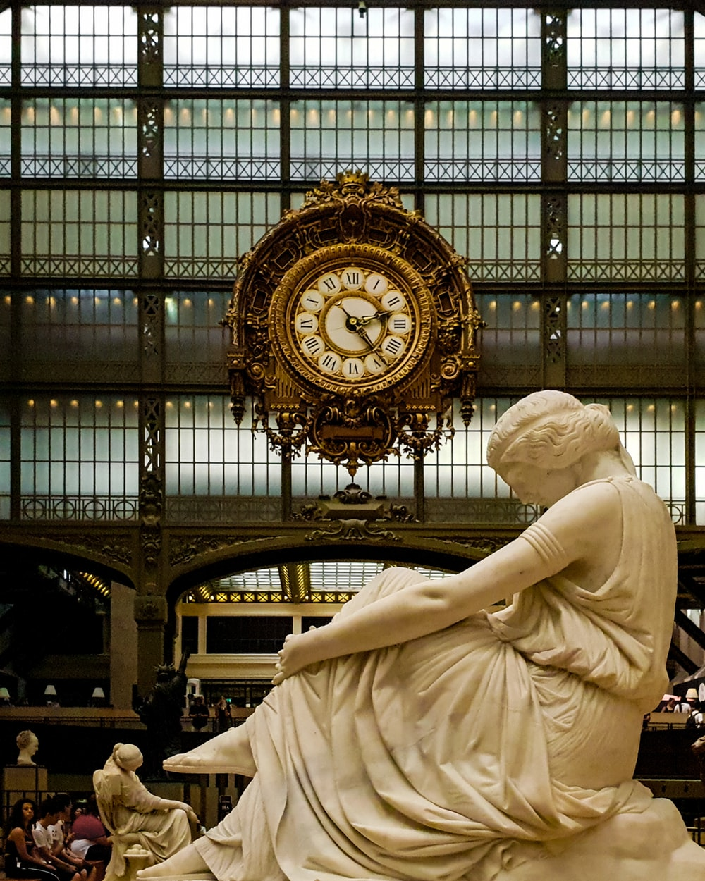 people sitting near Musee D'Orsay statue