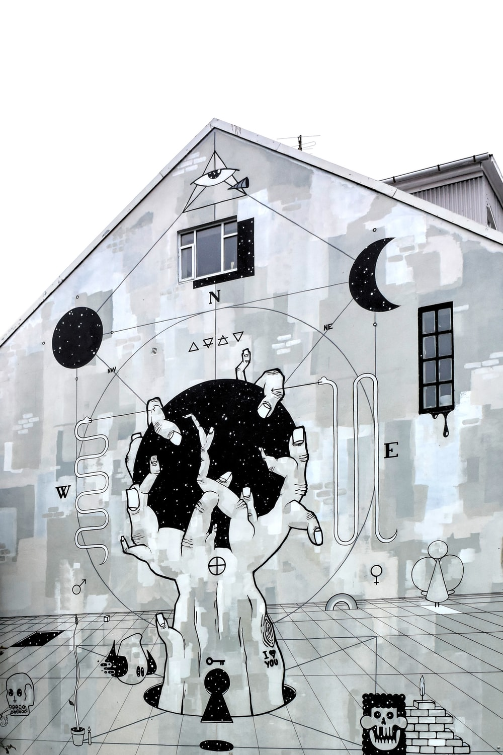 grayscale photography of concrete building with mural