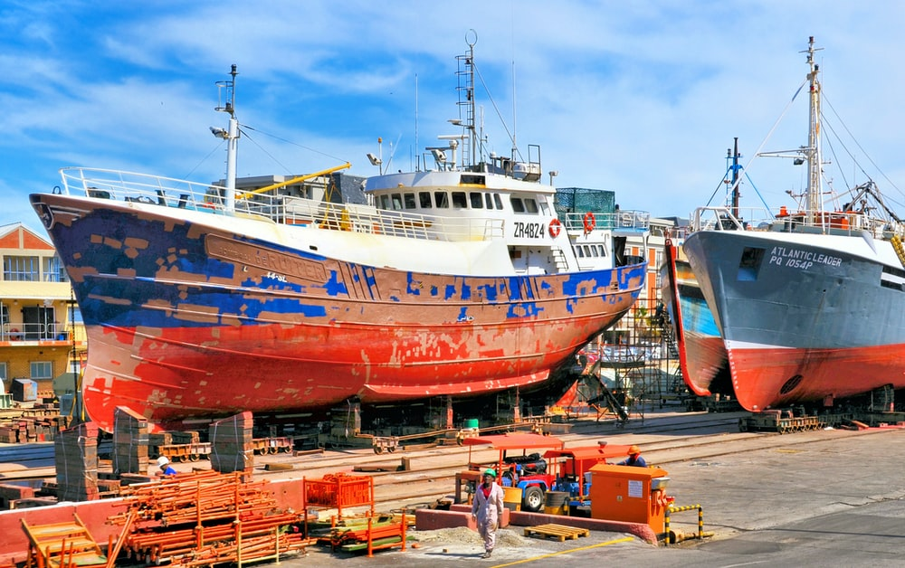 orange and blue ship