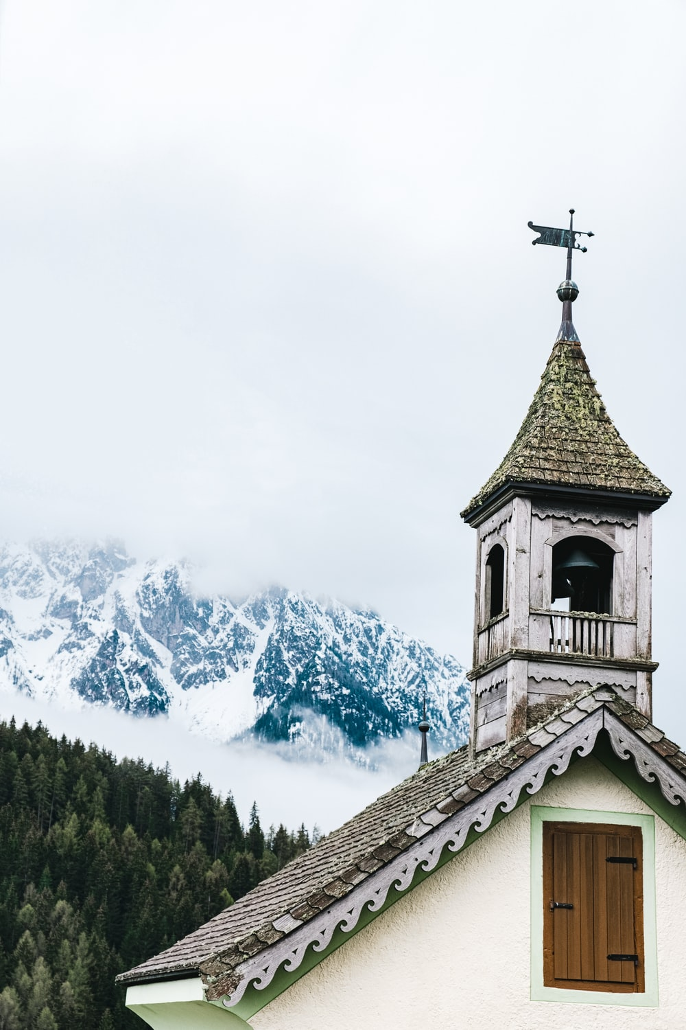 low-angle photo of green and white church