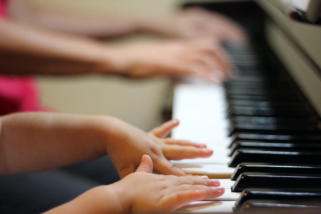 young and old on piano
