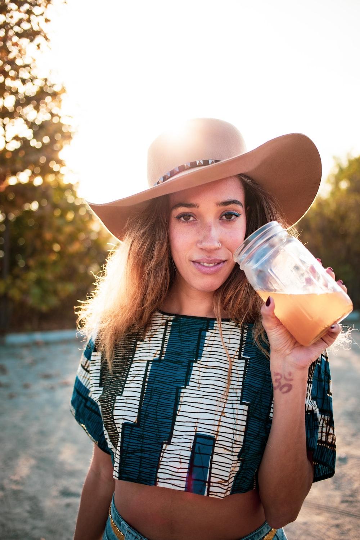 woman holding clear jar