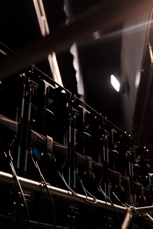 selective focus photo of five rectangular black speakers