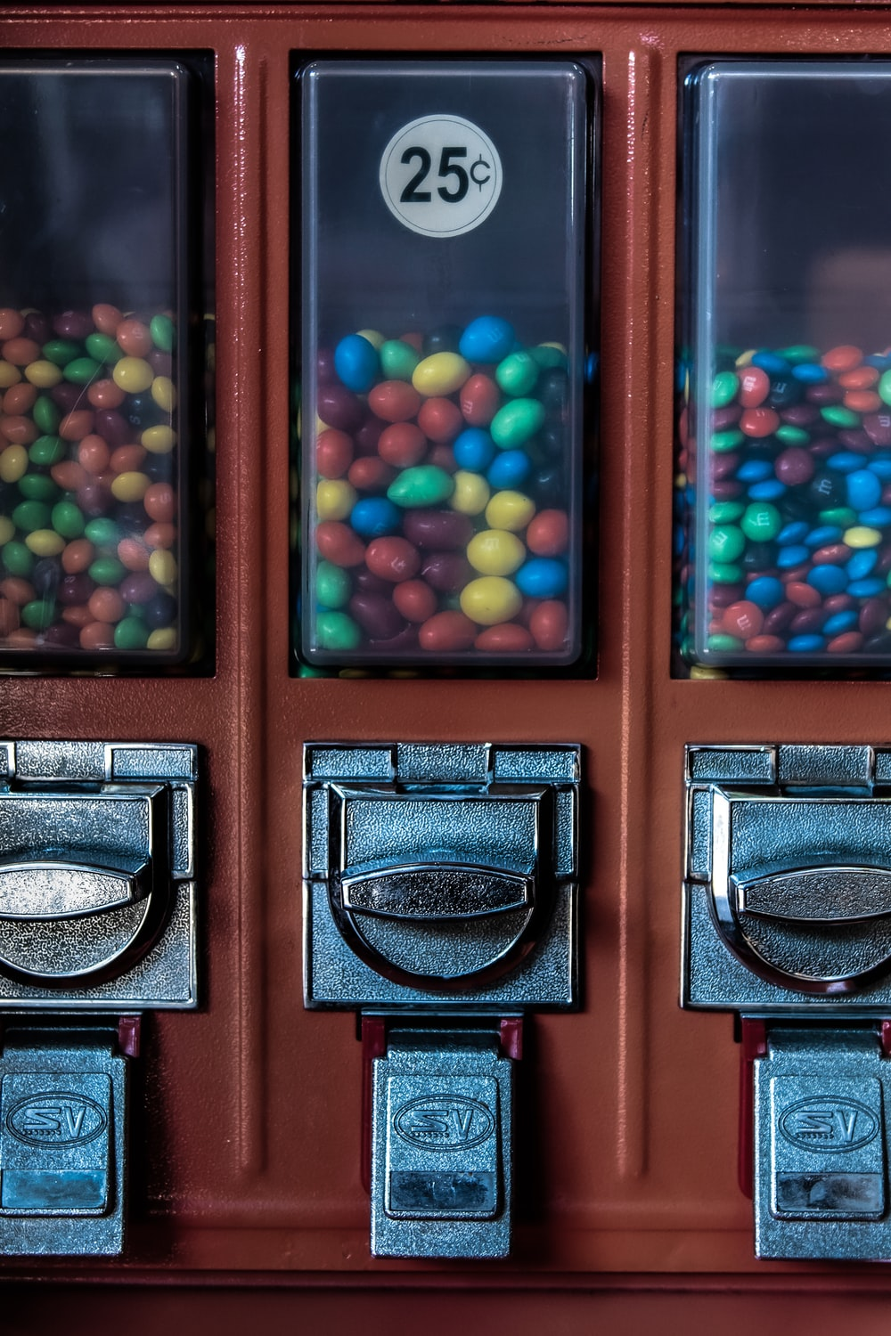 blue, yellow, and red candies on dispenser
