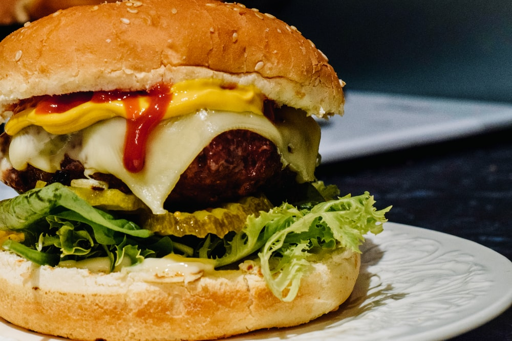 meat, cheese, lettuce and mustard burger