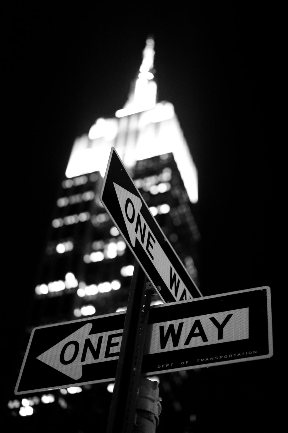 low-angle photography of One Way road sign at night