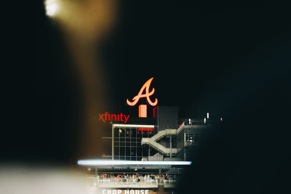 lighted Xfinity building at night