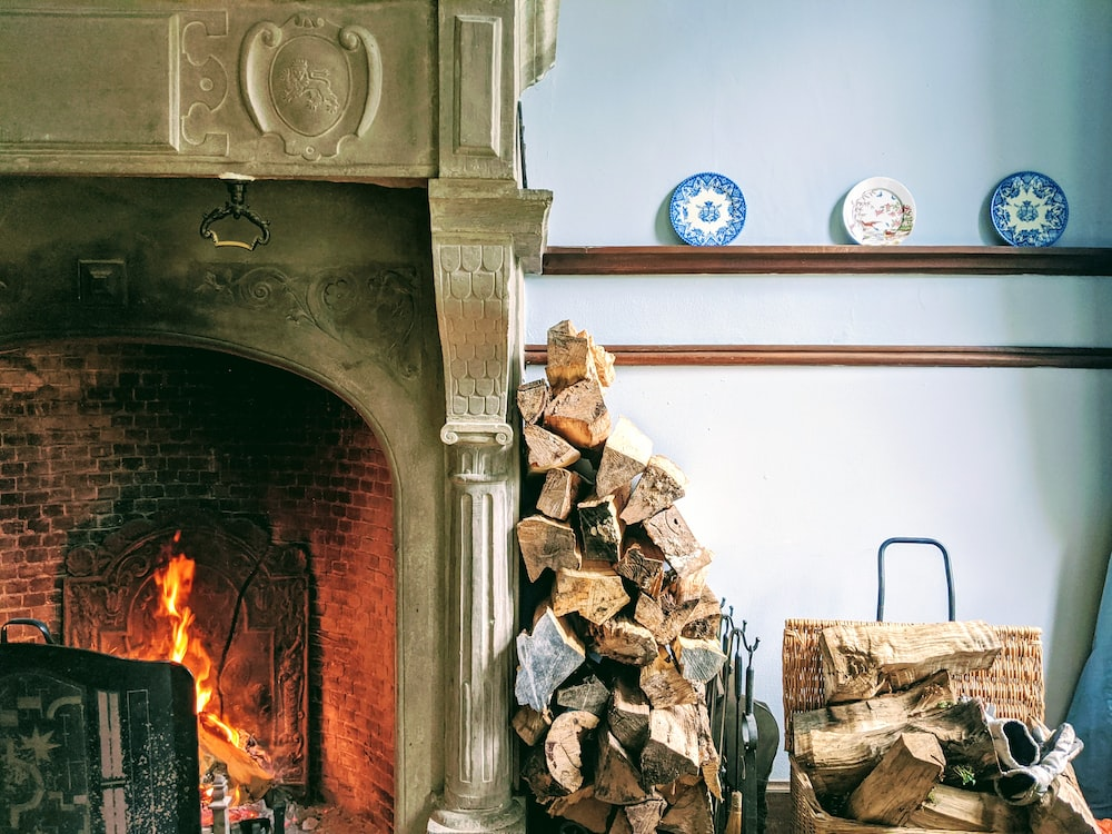 pile of fire woods beside fireplace