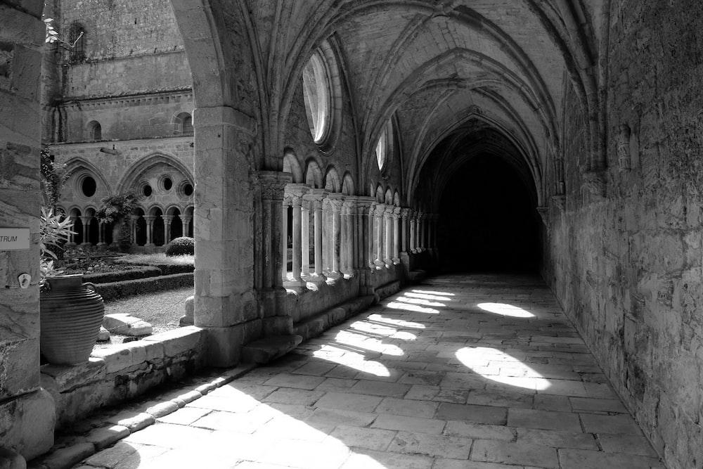 grayscale photography of empty hallway