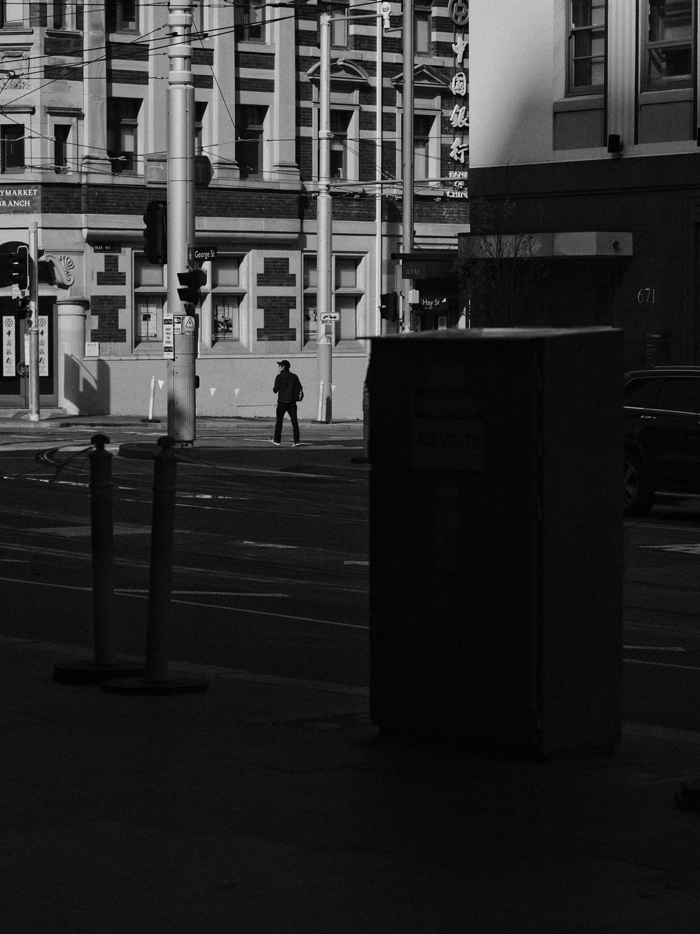 grayscale photography of person walking on road
