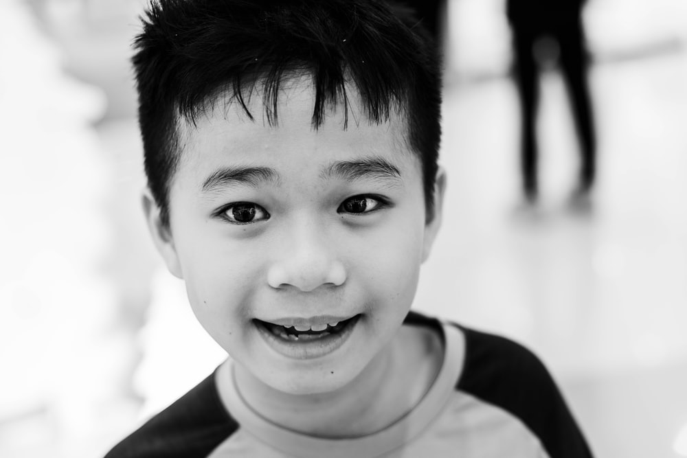 grayscale photography of boy