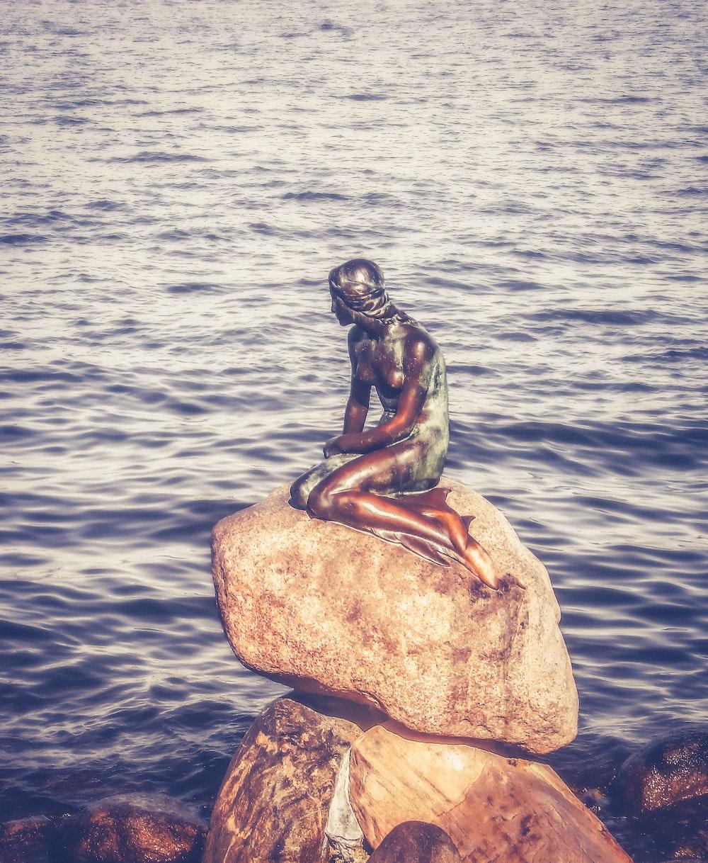 woman on rock statue