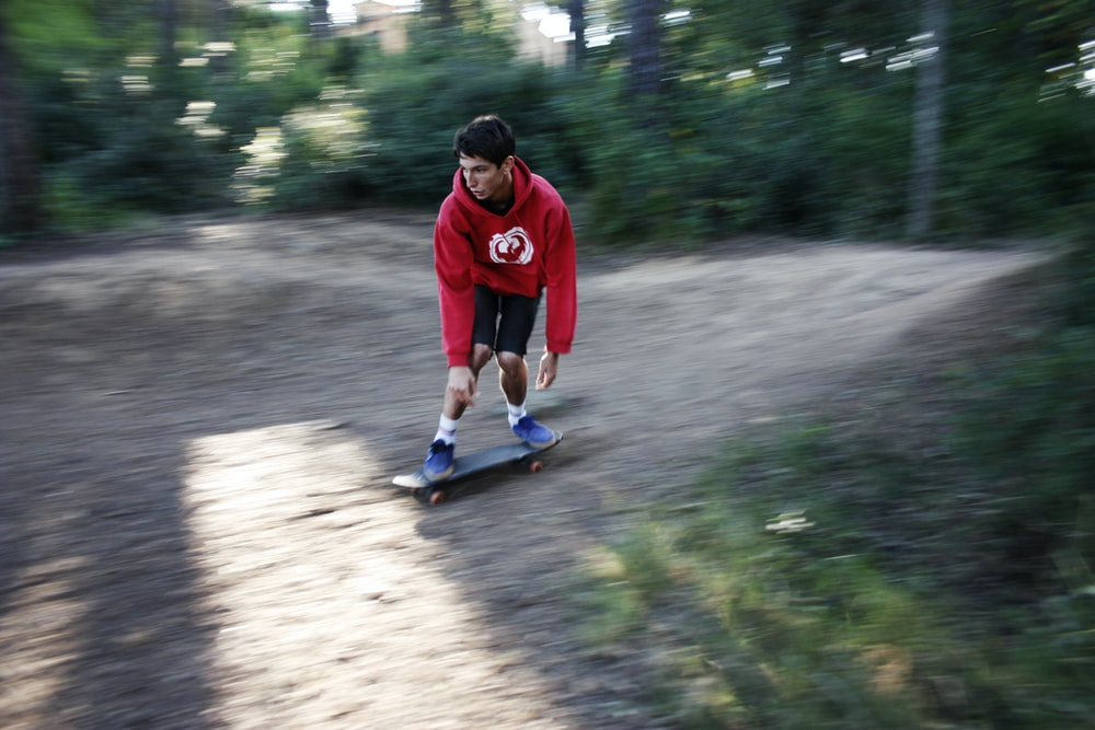 man in red hoodie skate boarding