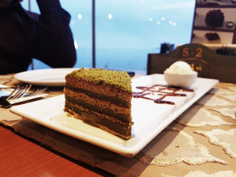 chocolate cake slice on rectangular white plate