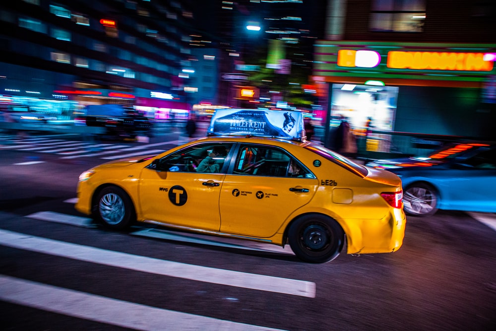 yellow cab on road