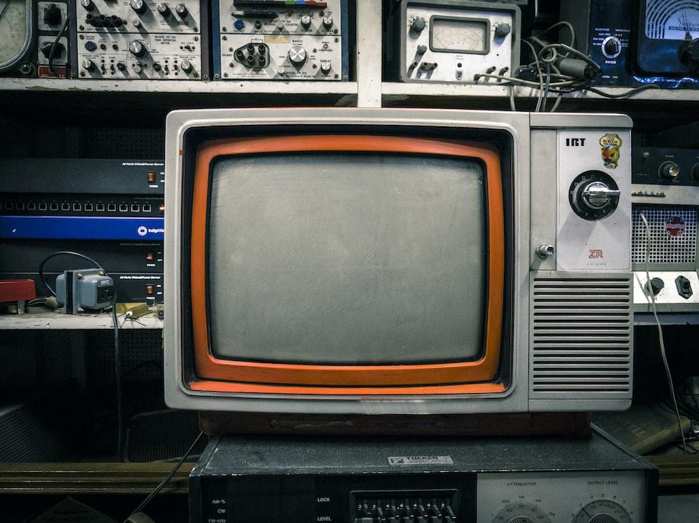grey and orange CRT TV