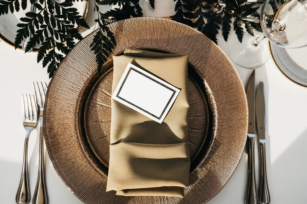 gray card on folded table napkin