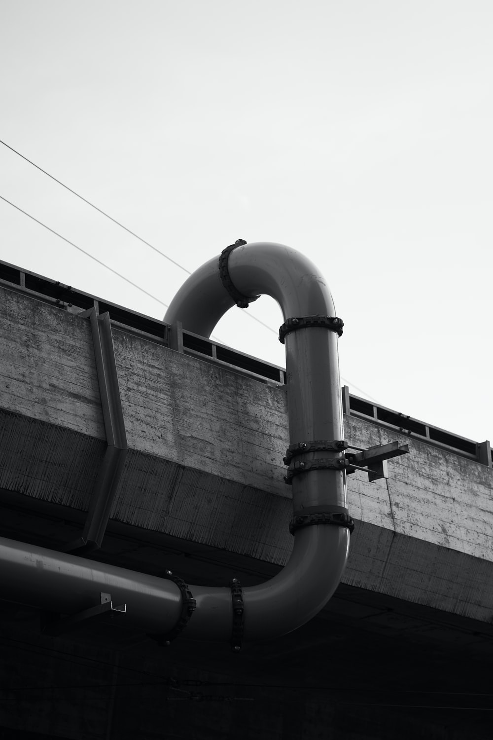 grayscale photography of black pipe