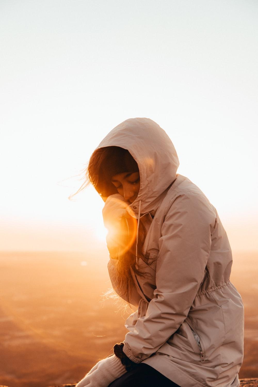 woman wearing beige jacket