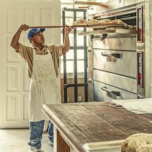 man wearing white apron