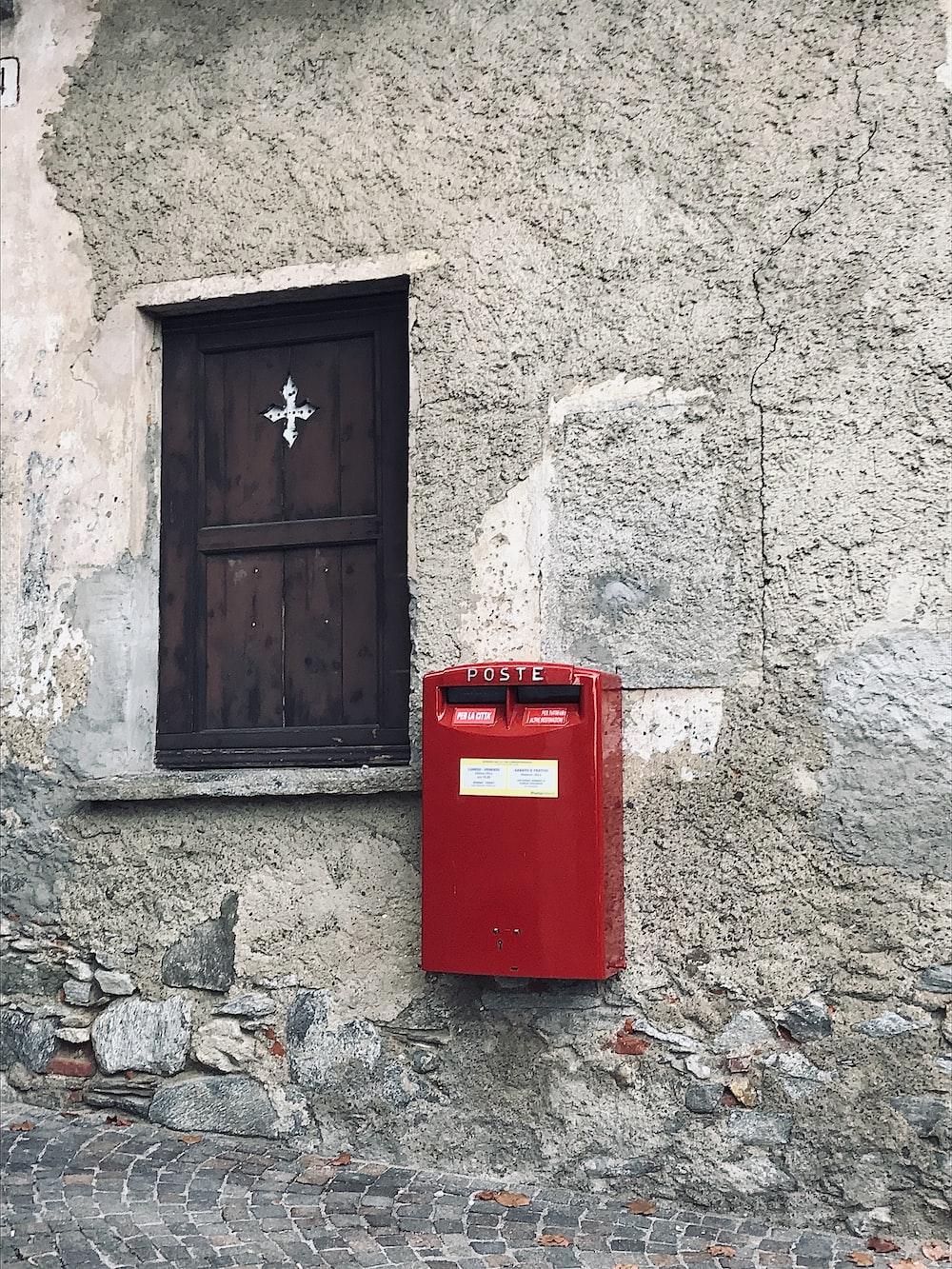 rectangular red metal mailbox