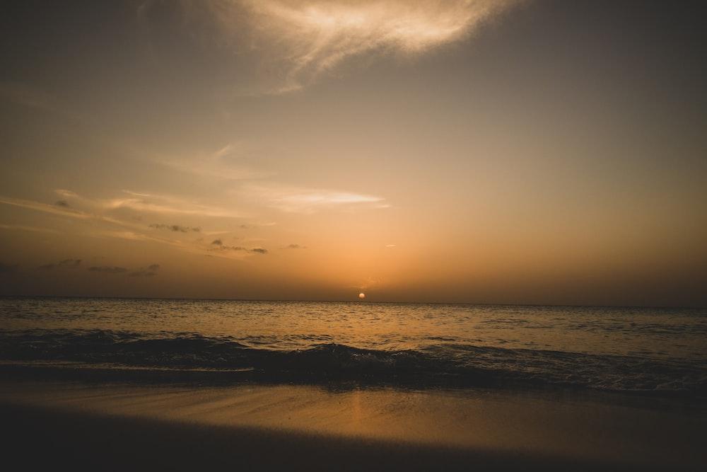 beach line under golden hour