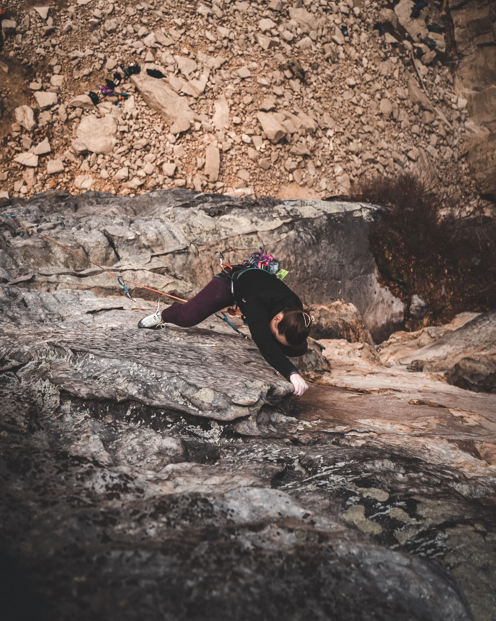 woman doing wall climbing at the cliff
