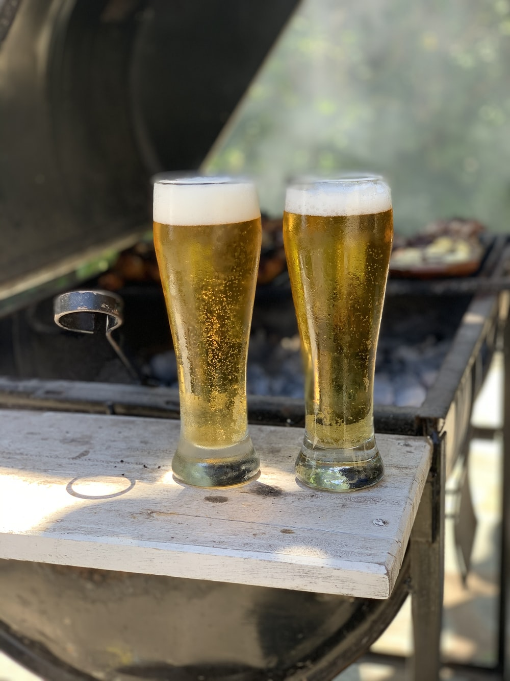 two pilsners filled with beer