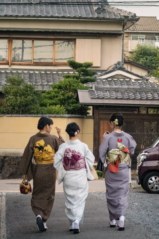 three women walking on paved raod