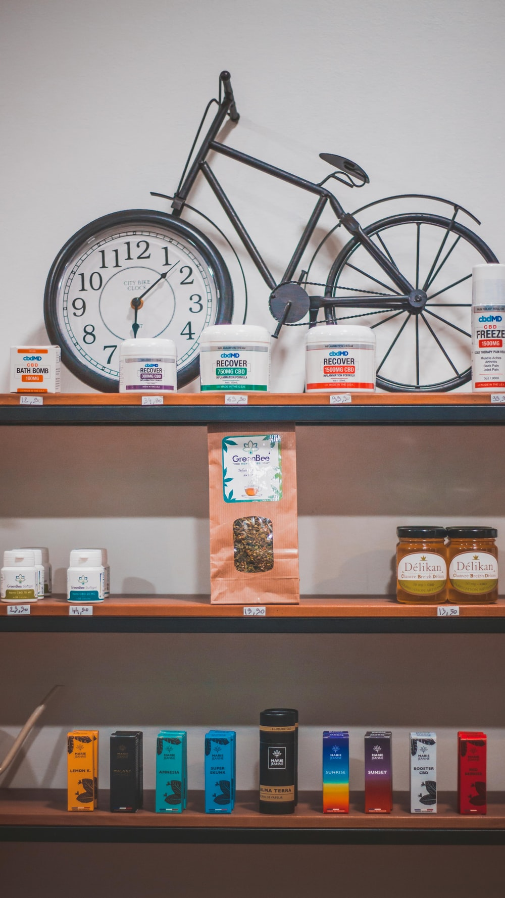 black bicycle analog clock on shelf
