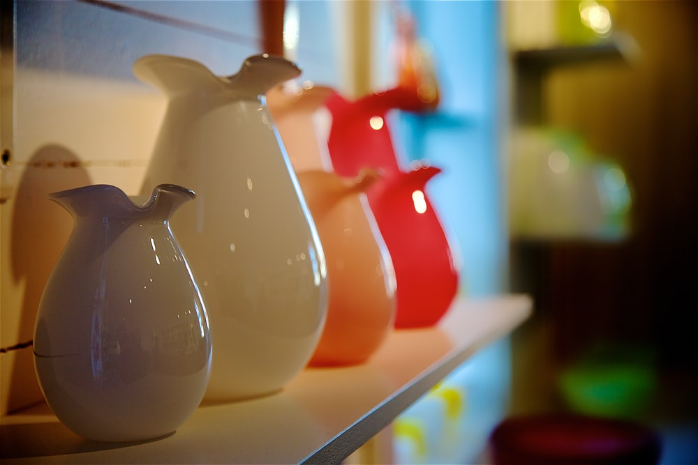 four assorted-color of pitchers