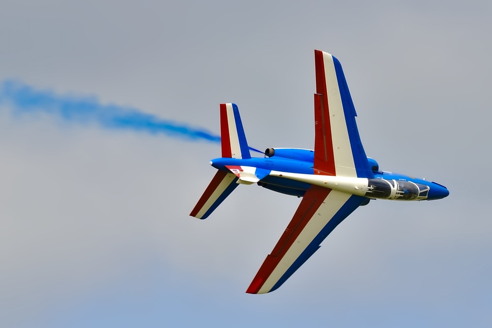 red,white, and blue airplane