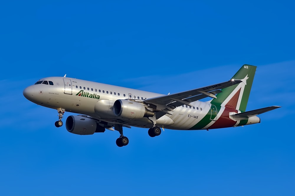white and green plane during daytime