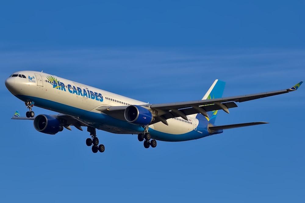 white and blue Air Caraibes passenger plane