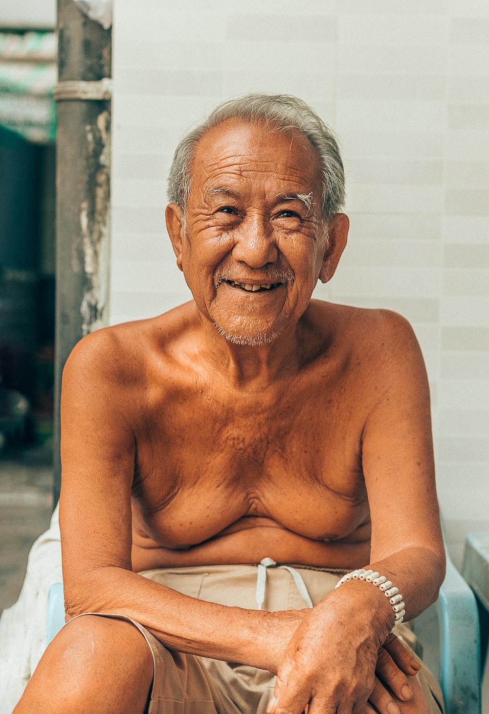 man wearing grey shorts sitting on chair